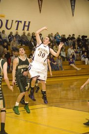 Marc Walbridge releases a floater in the lane in the second quarter of McLouth's Thursday home victory.