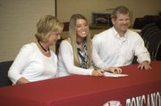 With her parents Karen and Mike Pursel at her side, Tonganoxie High senior Shelby Pursel signed a letter of intent with the Northeastern Oklahoma A&M College rodeo team on Feb. 15.