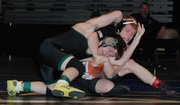 Bonner Springs' Caleb Seaton tangles with Bo Newport of Prairie View in the 125-pound state finals.