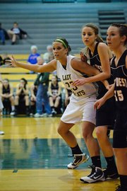 Basehor-Linwood senior Megan Bergstrom establishes position in the post during the Bobcats' substate first-round victory against Jeff West.