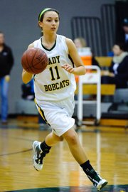 Basehor-Linwood senior point guard Courtney Poe leads the offensive attack during the Bobcats' substate victory against Jefferson County West.