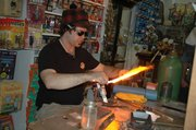Sammy Flowers, a marble artist from Duluth, Minn., demonstrates his lamp-working marble technique during Friday afternoon.