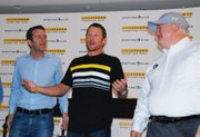 Professional cyclist and cancer survivor Lance Armstrong cracks a joke with Livestrong Foundation president and CEO Doug Ulman, left, and Sporting Kansas City co-owner Cliff Illig, right, near the end of the press conference announcing the Major League Soccer franchise's teaming with the Livestrong Foundation. The partnership includes naming the club's new stadium Livestrong Sporting Park.