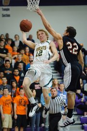 Basehor-Linwood senior Austin Laing glides past Bonner Springs junior J.J. Jackson on his way to the basket during the Bobcats&#39; victory in the substate semifinals.