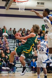 Basehor-Linwood senior Ryan O'Donnell goes for an acrobatic basket during the substate finals against Sumner Academy.