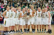 The Basehor-Linwood girls basketball team poses with the substate championship trophy after beating Sumner Academy, 41-37, on Saturday night in the Class 4A substate finals at Piper High School. BLHS improved to 18-4 and earned its second straight trip to the state tournament.