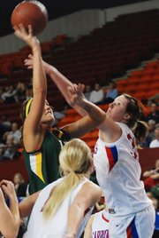 Basehor-Linwood senior forward Megan Bergstrom went toe-to-toe with Cheney senior forward Merissa Quick during the state semifinals.