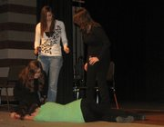 """From left, Jessica Morris, Cammie Mitchener and Sky Morrell arise from their chairs after Emily Lynch collapses during a rehearsal of """"Under the Influence,"""" the Basehor-Linwood High School spring play. Before and after the performances this week, representatives will be available from drug and alcohol treatment organizations in the area."""