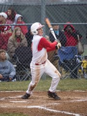 Tonganoxie High senior Dylan Puhr hits a single in the bottom of the seventh inning Thursday against Basehor-Linwood. The Chieftains lost both games of a home doubleheader against BLHS.
