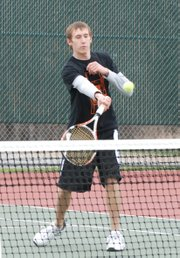 Lucas Isaacs executes a drop shot at the net during his doubles victory against Bishop Miege. Isaacs helped Bonner Springs to a 5-3 victory in the tennis dual.