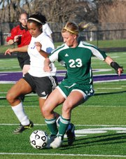 Kara Stephens, Basehor-Linwood sophomore, outduels Pipers Skylar Johnson for possession of the ball during the first half Tuesday at PHS. Stephens won this particular possession, but Piper won the game 10-0.