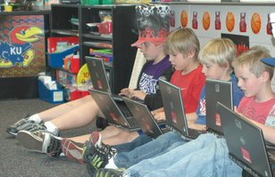 Students at Horizon Elementary study math by playing video games during a recent joint class session.