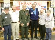 Pictured, from left to right: Maury Dubinsky, Overland Park, Navy fighter pilot off USS Intrepid; Ed Boswell, Prairie Village, Marine rifleman at Iwo Jima; Norman Hudson, Lenexa, Army communications officer, Pacific Island 