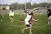 Tonganoxie High senior Lucas Ahart throws his javelin Monday at the Tonganoxie Invitational. The THS boys finished third and scored most of their points in field events.