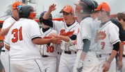 Gonzalo Pichardo (31) is congratulated by his teammates after smashing a two-run home run during the Braves doubleheader sweep of Eudora on Monday.