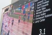 Daniel Prioleau, second from right, is seen on the video board competing in the 100-meter dash at the Kansas Relays.