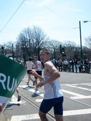 Levi Huseman, 23, Tonganoxie, looks back at his friends in the crowd while running in the Boston Marathon on April 18.