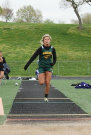 Basehor-Linwood's Shelby Equels charges down the runway during the long jump competition at the Bonner Springs Invitational.