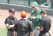 Bonner Springs coach Barry Richards and Basehor-Linwood coach Brian Lohafer converse with the umpires prior to their squads' championship semifinal game at the Butch Foster Memorial Baseball Classic Friday, April 29, 2011.