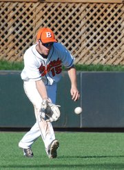 Bonner Springs center fielder Shawn Jones scoops up a ball during the Braves' third-place game against Spring Hill at the Butch Foster Memorial Baseball Classic at CommunityAmerica Ballpark.