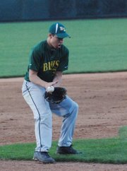 Basehor-Linwood third baseman Tyler Ogden knocks down a chopper before throwing to first base for an out during the Bobcats' game against Holton in the finals of the Butch Foster Memorial Baseball Classic.