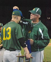 Basehor-Linwood baseball coach Brian Lohafer puts a championship medal on Jared Patton after BLHS won the Butch Foster Memorial Baseball Classi.