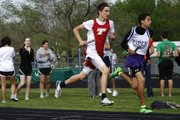 THS freshman Evan Stilgenbauer gets some air underneath his feet while running his leg of the 4x800 relay race Friday at De Soto.