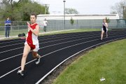 THS freshman Hunter Cook runs in the 4x800 relay on Friday at the De Soto Invitational.