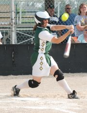 Basehor-Linwood's Olivia Cowan sends a bloop single to right field during the Bobcats' 12-2 victory against Turner.