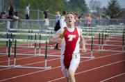 Matt Briggs pushes himself toward the finish line while running the final leg for Tonganoxie's 4x800 relay team, which finished third at the KVL Meet.