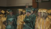 Soon-to-be graduates of Basehor-Linwood High School gather in the school&#39;s small gymnasium before their commencement on May 12.