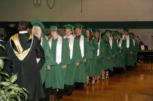 Graduates of the De Soto High School Class of 2011 line up to receive their diplomas during graduation ceremonies on Saturday, May 21.