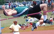 Basehor-Linwood's Ben Johnson glides over the bar in the high jump competition at the Class 4A track and field state championships.