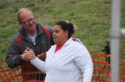 Tonganoxie High senior thrower Domino Grizzle is congratulated by THS throws coach Matt Bond after finishing second place in Class 4A state shot put Saturday morning at Cessna Stadium in Wichita.