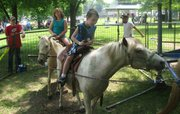 Zach Smith, in the foreground, enjoys a pony ride at Basehor Dairy Days on Saturday.