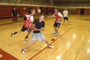 Ben Williams pivots toward the basket at THS boys basketball camp on June 1.