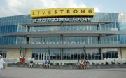 A few early fans linger in front of LIVESTRONG Sporting Park prior to Sporting Kansas City&#39;s inaugural game in its new stadium Thursday June 9, 2011.