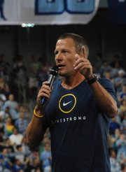 Seven-time Tour de France winner and Livestrong founder Lance Armstrong addresses the crowd prior to the inaugural game at LIVESTRONG Sporting Park on Thursday June 9, 2011.