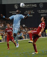 Sporting Kansas City's Kei Kamara wins a ball in the air during the squad's 0-0 tie with the Chicago Fire.
