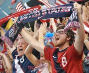 A fan in the cauldron section celebrates after Jozy Altidore gave the United States a 1-0 lead.