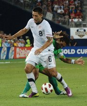 Clint Dempsey works his way past a Guadeloupe player during the first half of the United States&#39; 1-0 victory in the Gold Cup.