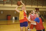 Tonganoxie post player Emma Stilgenbauer goes up for a basket on Thursday at THS girls basketball camp.