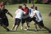 Tonganoxie High defensive lineman Connor McClellan tries to get into the backfield as the Chieftains review plays on Wednesday, June 15 at THS football camp.