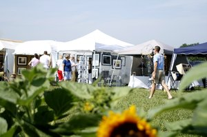 "Nearly 20 artists set up booths a Zimmerman's Kill Creek Farm to participate in the third annual Sunflower ArtFest on July 8-9. The festival, which is sponsored by the De Soto Arts Council, featured local and regional artists as well as a special, sunflower-themed exhibit. ""We're so pleased with this year's results,"" said De Soto Arts Council member and event organizer Carrie Dvorak. ""The festival has grown from past years and we have such a variety of artwork and we've really gotten the community involved, it's wonderful."""
