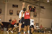 A rising Tonganoxie High senior, forward Tavia Brown puts a shot up over the Maranatha Academy defense in a 43-19 THS victory at Bonner Springs on July 6. The Chieftains finished in the Bonner Springs summer league with an 8-0 record.