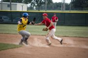 Post 41 shortstop Dylan Puhr chases down an Easton base runner before tagging him in a scrimmage on Tuesday at Leavenworth County Fairgrounds.