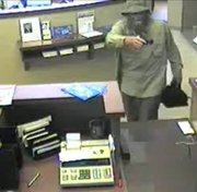 Authorities are looking for this man, captured on surveillance tape July 25 while robbing the Bank of Blue Valley, 5520 Hedge Lane Terrace in Shawnee.