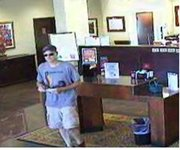 The FBI believes this man — captured on surveillance video prior to donning a disguise — may be responsible for a July 25 bank robbery in Shawnee, as well as four Oklahoma heists and one in Joplin, Mo.