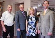 Pictured from left: Tom Ohmes, Gregg Amos, Anne Smith and Mark Smith of The Amos Family Funeral Home. Anne Smith is the pet cremation consultant for the funeral home's Amos Family Pet Companion Crematory. Ohmes performs nearly all of Amos' pet cremations.