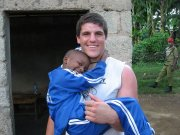 Matt Acree spent time playing with orphans like Derrick in Tanzania as part of a two-week trip with the Drake University football team in May.